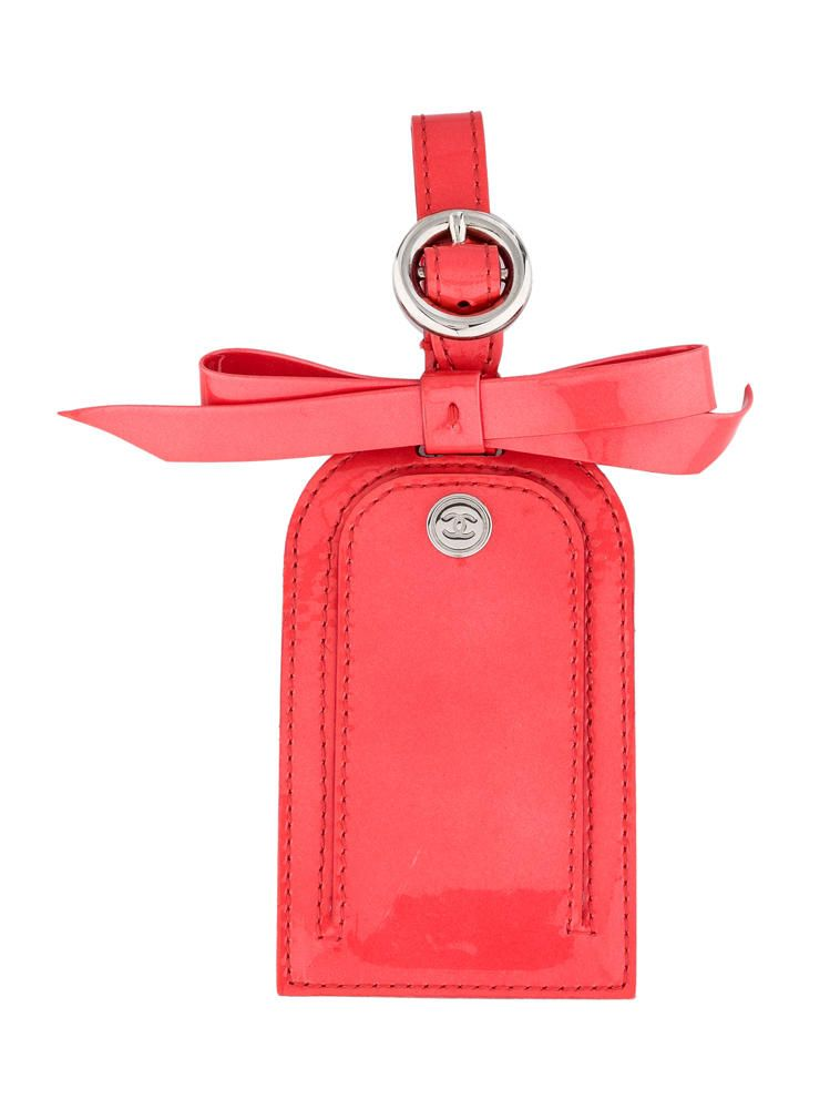 61cf66f83e93 Red Chanel patent leather luggage tag with bow appliqué, silver-tone  hardware, buckle closure and interlocking CC snap closure.