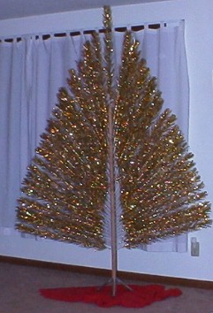 the 2 dimensional gold peacock style aluminum xmas tree on ebay update sold for 395 dollars - Aluminum Christmas Tree Ebay