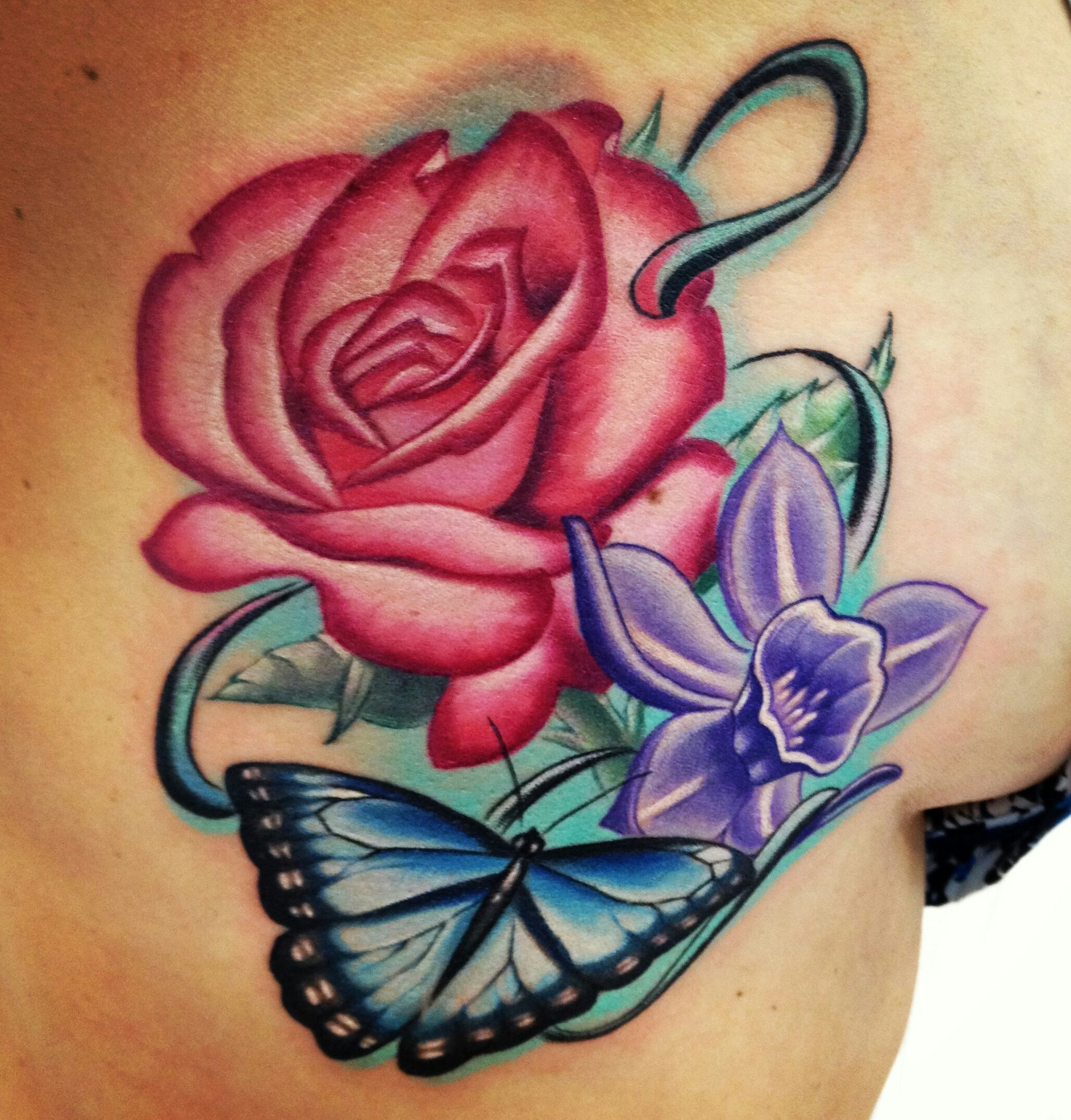 Birth flower tattoo on ribs. The rose for June and