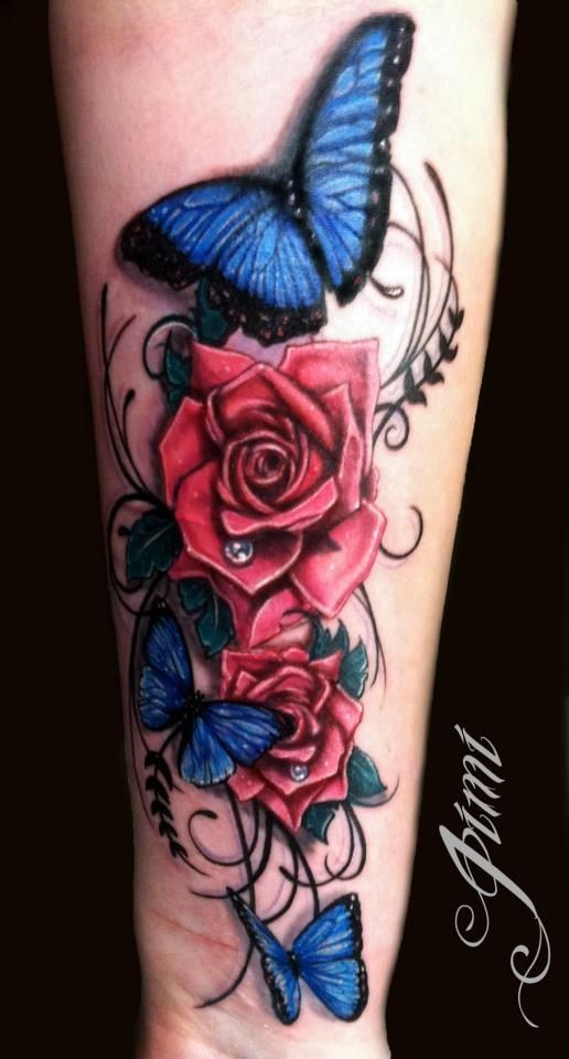 These Colors Just Pop Right Off The Arm And The Roses Sooooo Dimensional So Deep Bam Butterfly Blue Rose Tattoos Rose Tattoos Rose And Butterfly Tattoo
