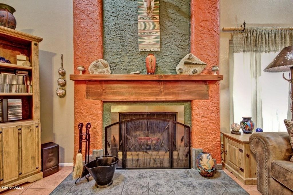 Southwestern fireplace with contrasting colors ... on