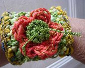pretty hand made crochet green,yellow cuff bracelet,jewelry, ornated with an orange flower