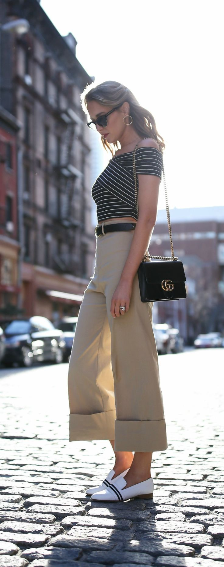 Top 10 Spring Trends to Know // How to Wear Trend #7: Khaki // click the image for all the details! // khaki wide-leg cuffed culotte trousers, white loafers with striped ribbon detail, black and white stripe criss-cross off-the-shoulder crop top, black waist belt, gucci gg bag {spring fashion, style, rag and bone, sea}