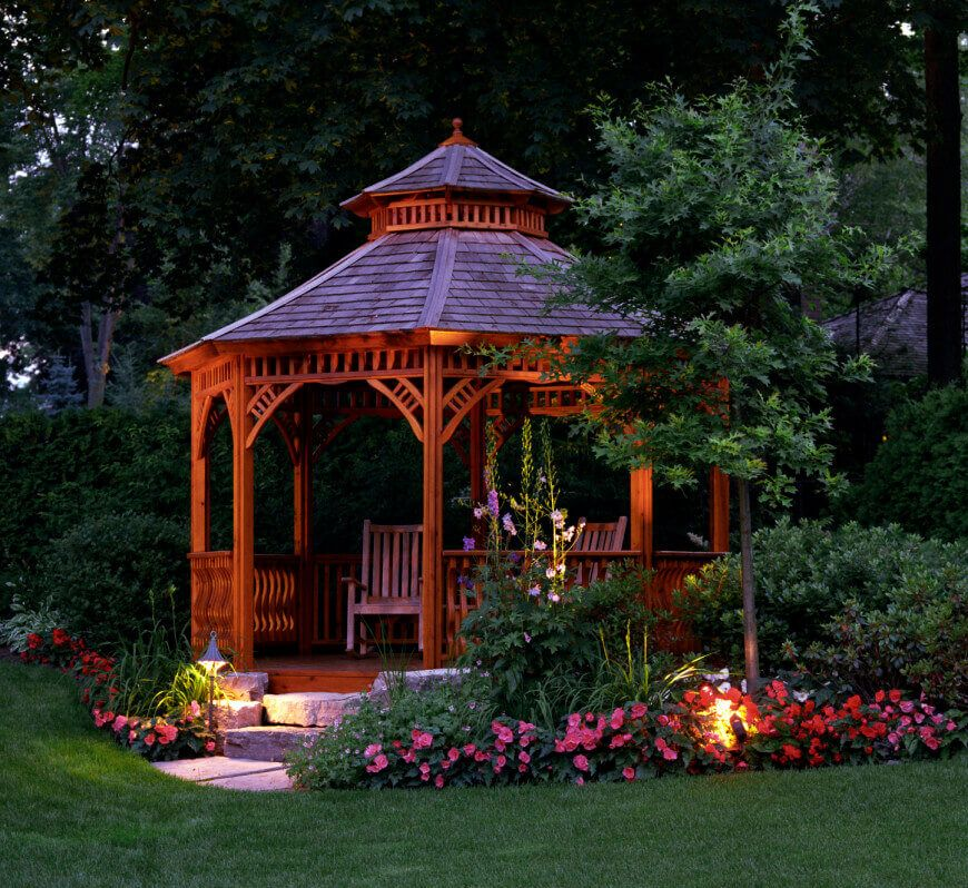 This Gazebo Is A Marvelous Example Of A Gazebo Garden It Uses A Combination Of Pink And Purple Flowers With Different Lighting Fixtures To Liven Up The