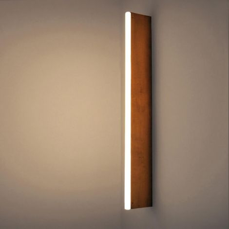 linestra tube light by michael anastassiades in brass with a lamp lamppu