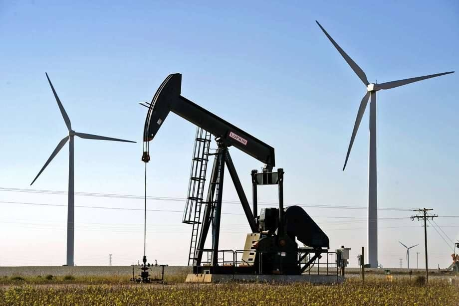 Wind turbines and oil pumpjack in action near Midland TX