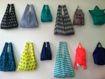 Baggu - great bags that fold in your purse. love the colors/patterns. so practical