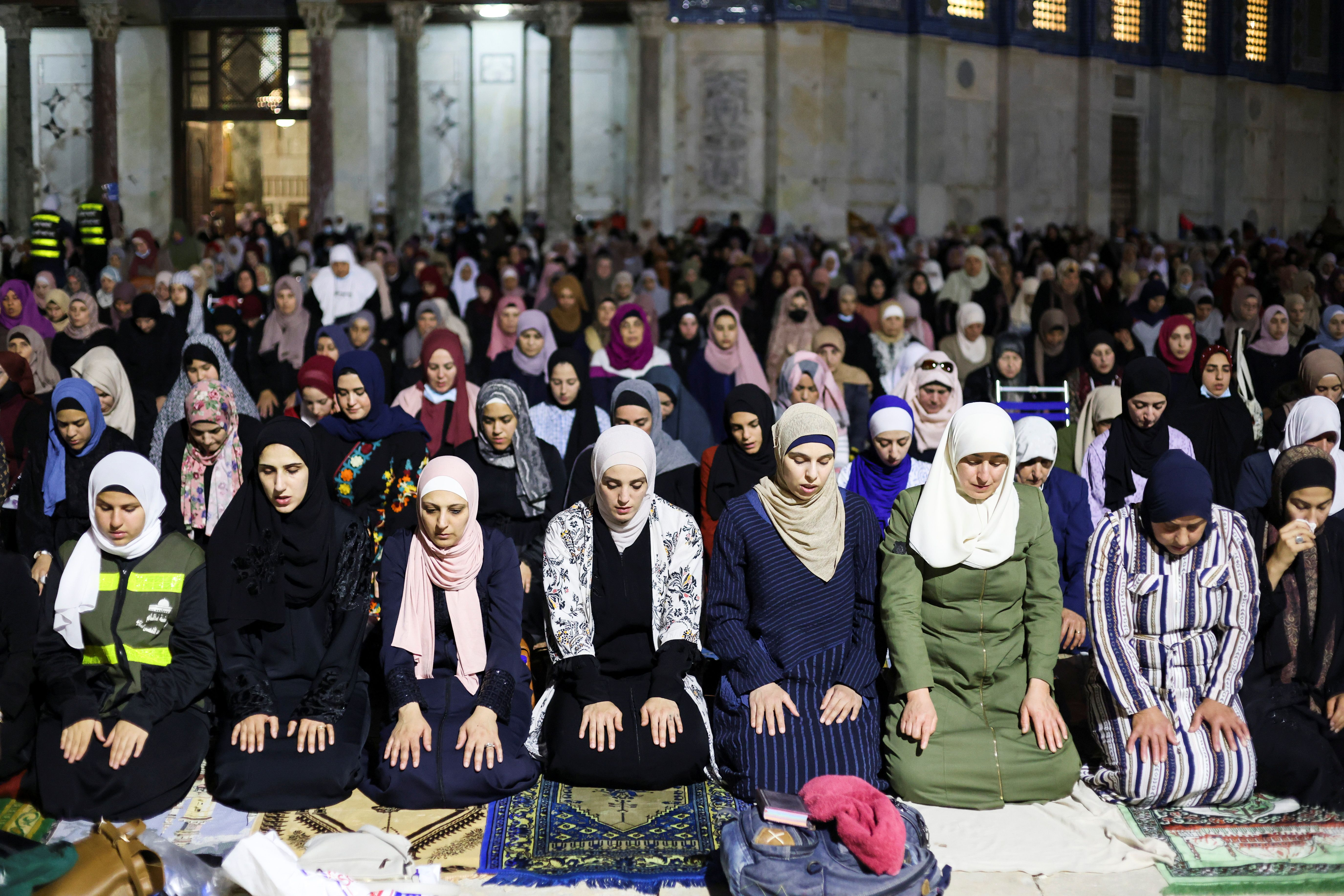 Palestinians pray in the compound that houses Al-Aqsa Mosque in Jerusalem's Old City [Ammar Awad/Reuters]   Al Aqsa Mosque attacked