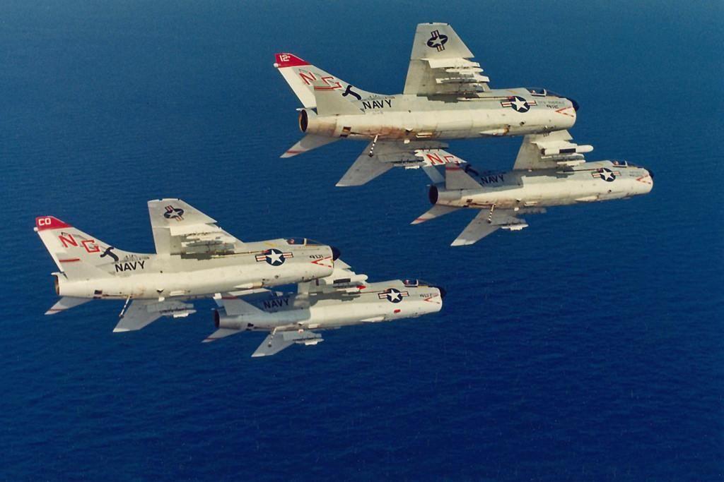Stunning VA-147 Argonauts formation of A-7B Corsair off USS Constellation (CV64) over the Persian Gulf, ca.1975.