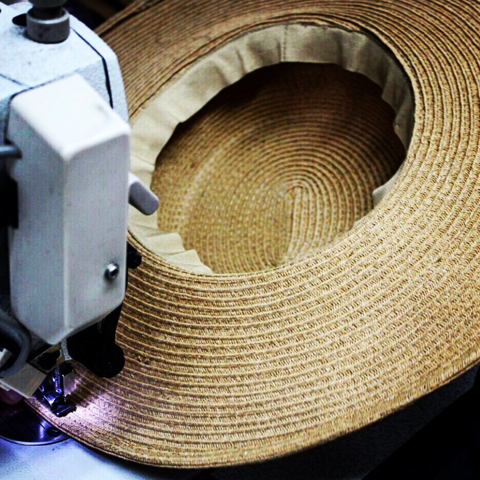 SEW GOOD custom straw boater hats on the production line for Summer ... 3afe67a3f48