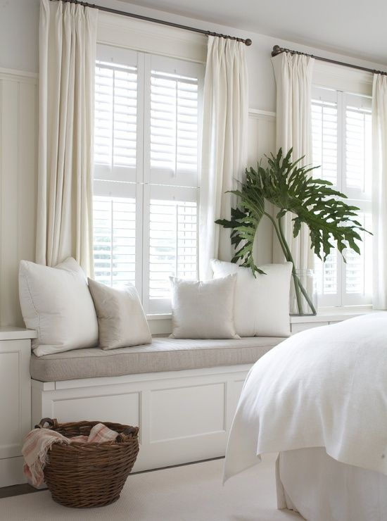 White plantation shutters and built in window seats our for Window seat curtains