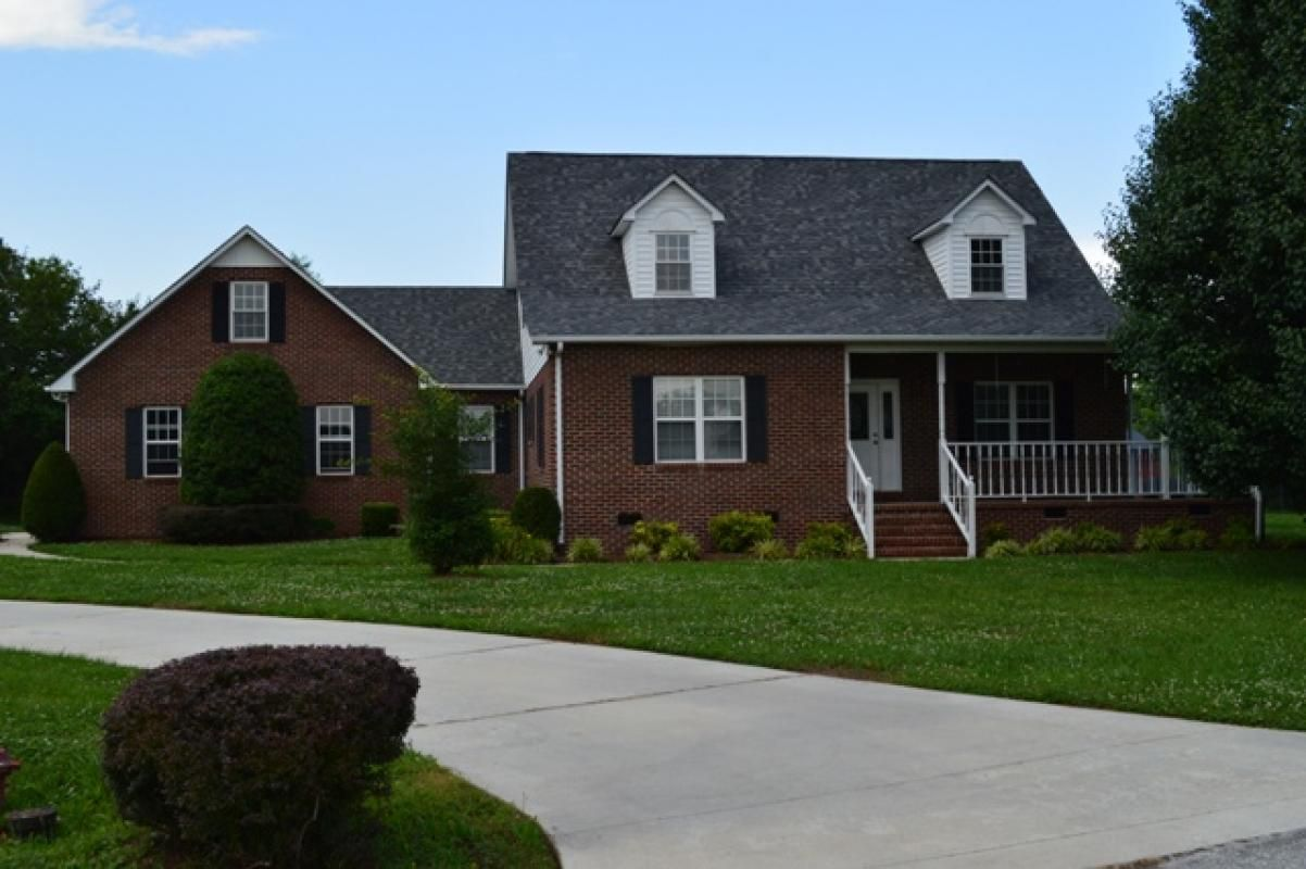 Beautiful brick home with extra large lot this home features a