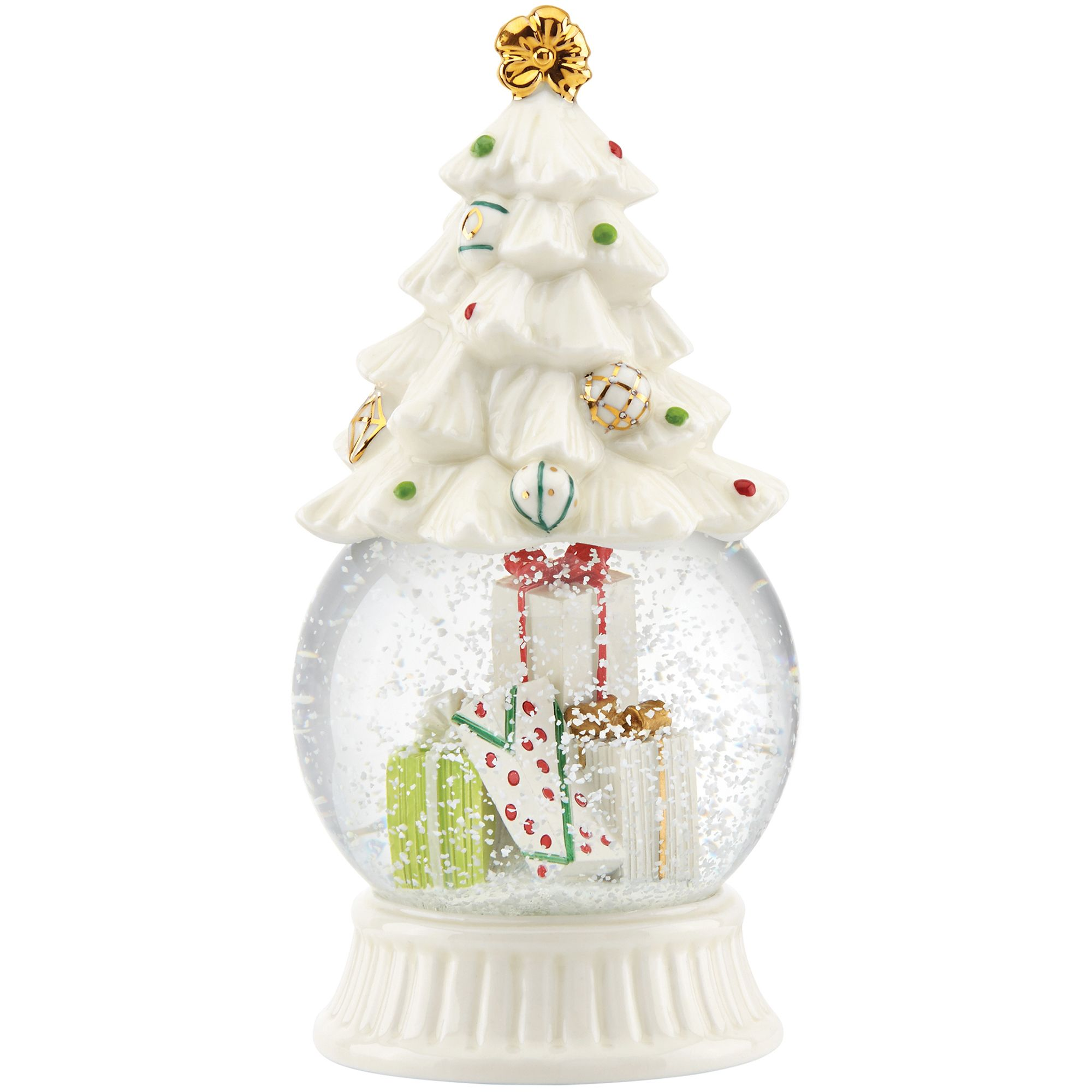 Snowing christmas decoration let it snow - A Decorated Porcelain Christmas Tree Tops The Snow Globe With Colorful Presents Inside The Globe