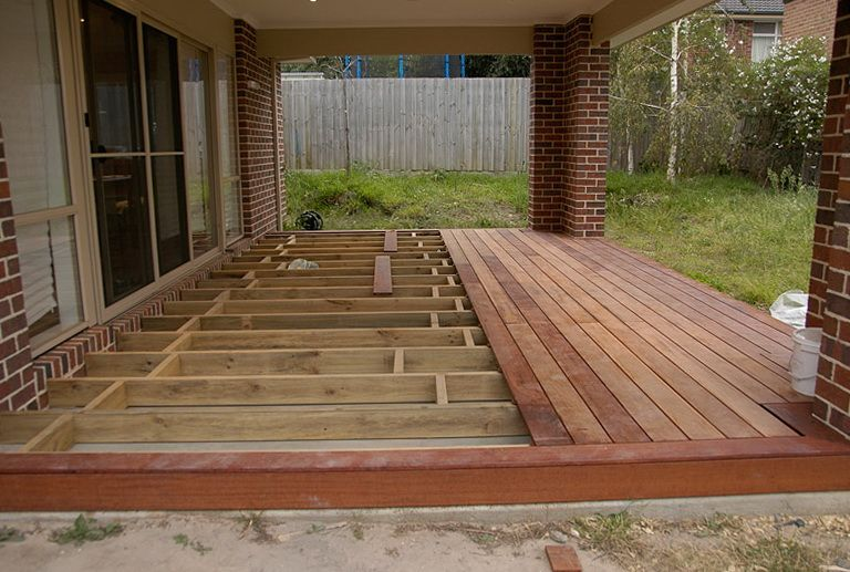 Building a floating deck over concrete slab hardscape Building a deck