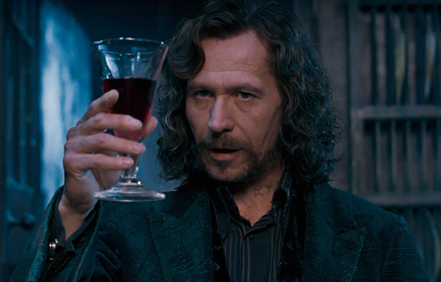 In Order of the Phoenix, Sirius is the first to stand at a table of 13.