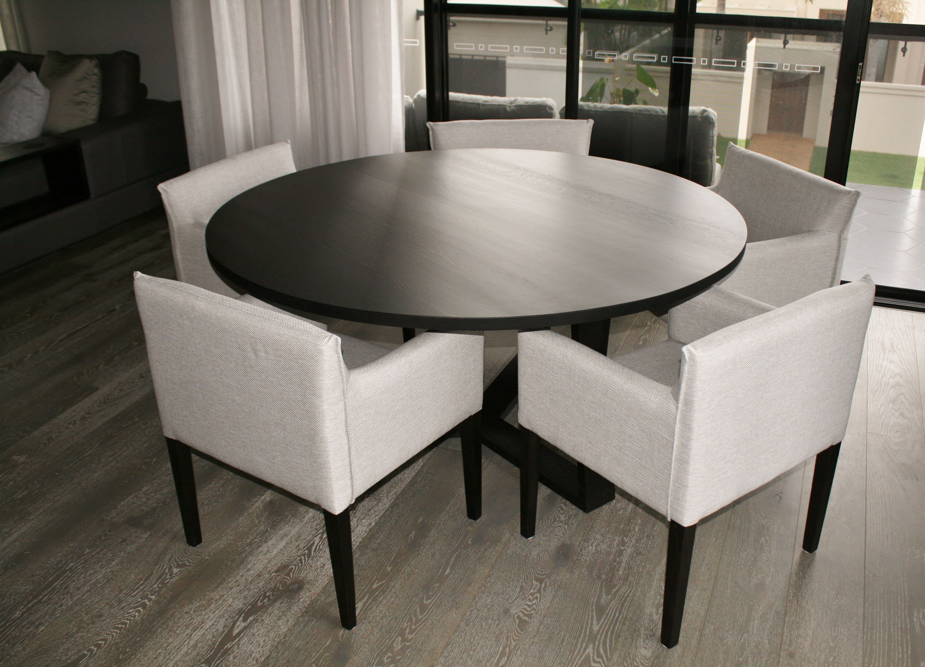Pure dining table finished in black japan by rzid interiors www rzid com