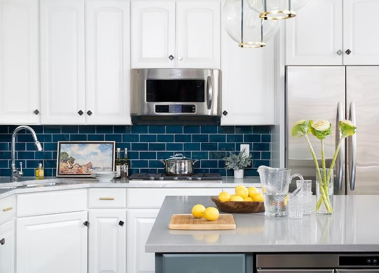 Blue And White Kitchen With A Corner Sink Featuring Dark Blue
