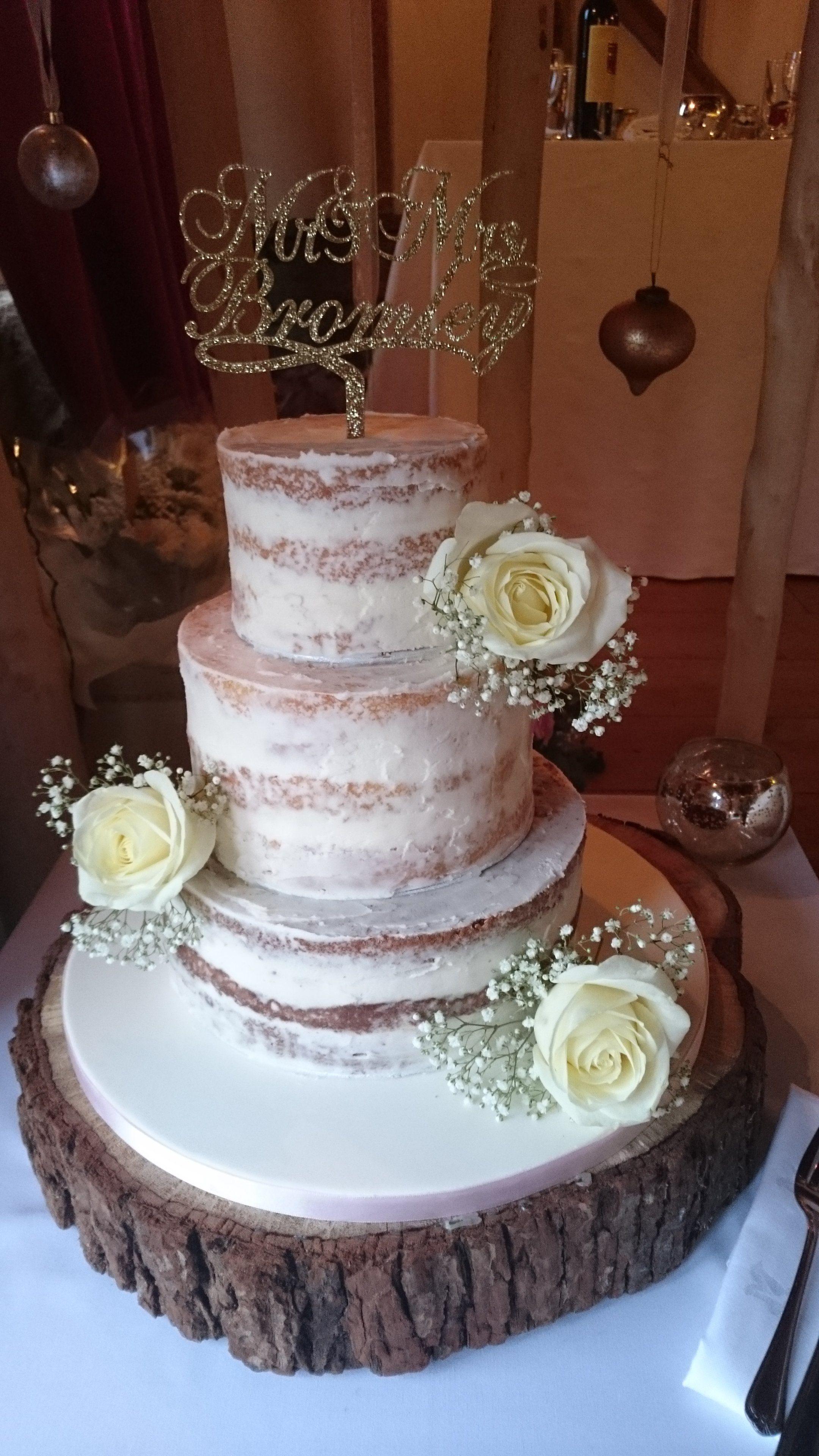 3 tier Semi Naked wedding cake with fresh roses ...