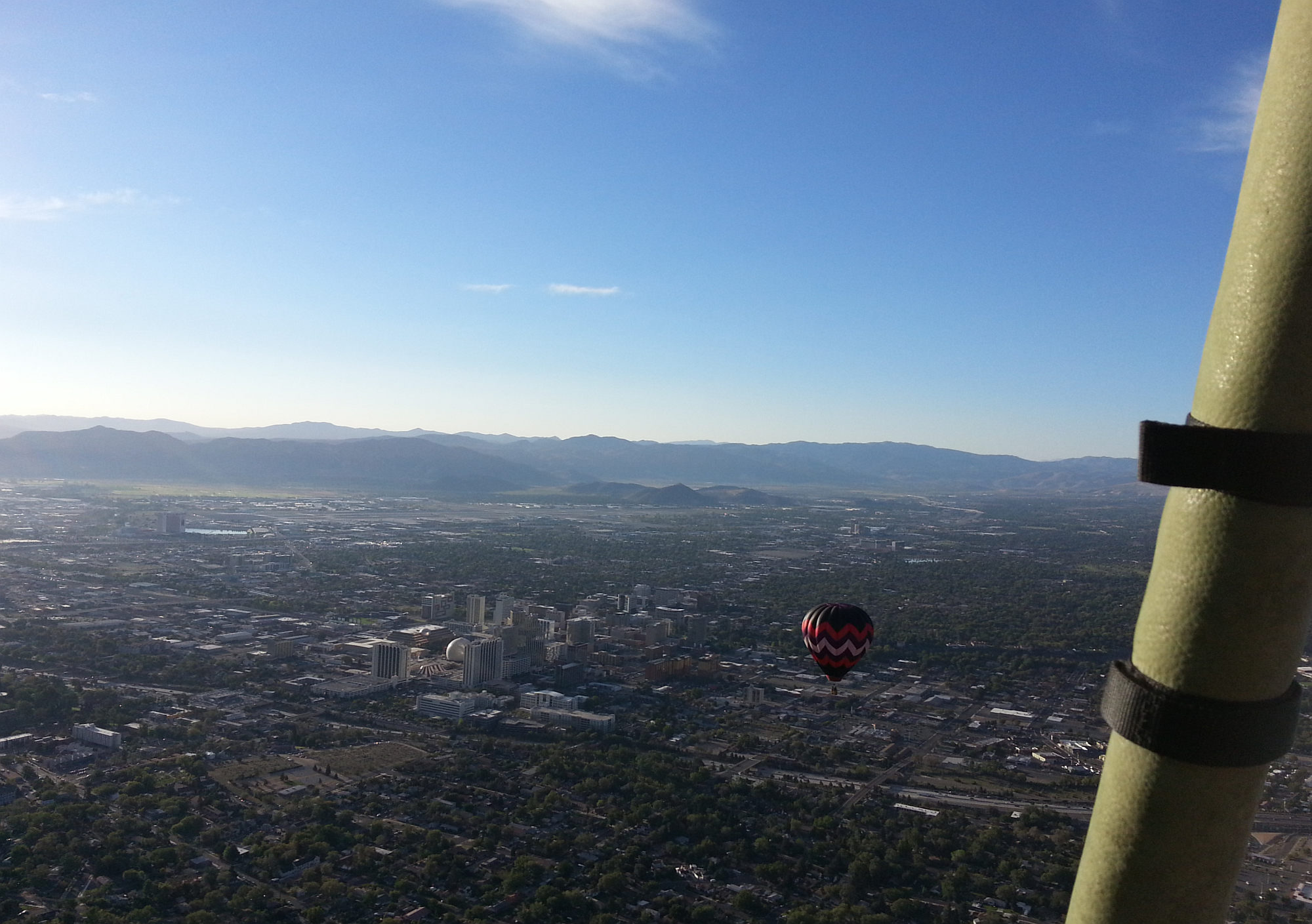 Downtown Reno Nevada from the basket of our Cheers Balloon, with Mariposa II Balloon nearby.