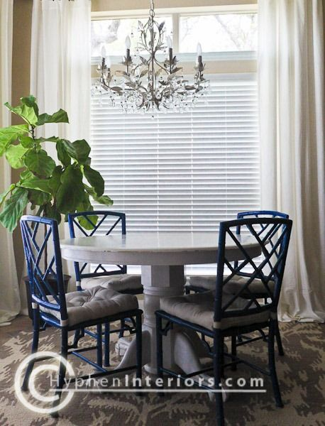 Painted pedestal table, with old modern dining chairs ...
