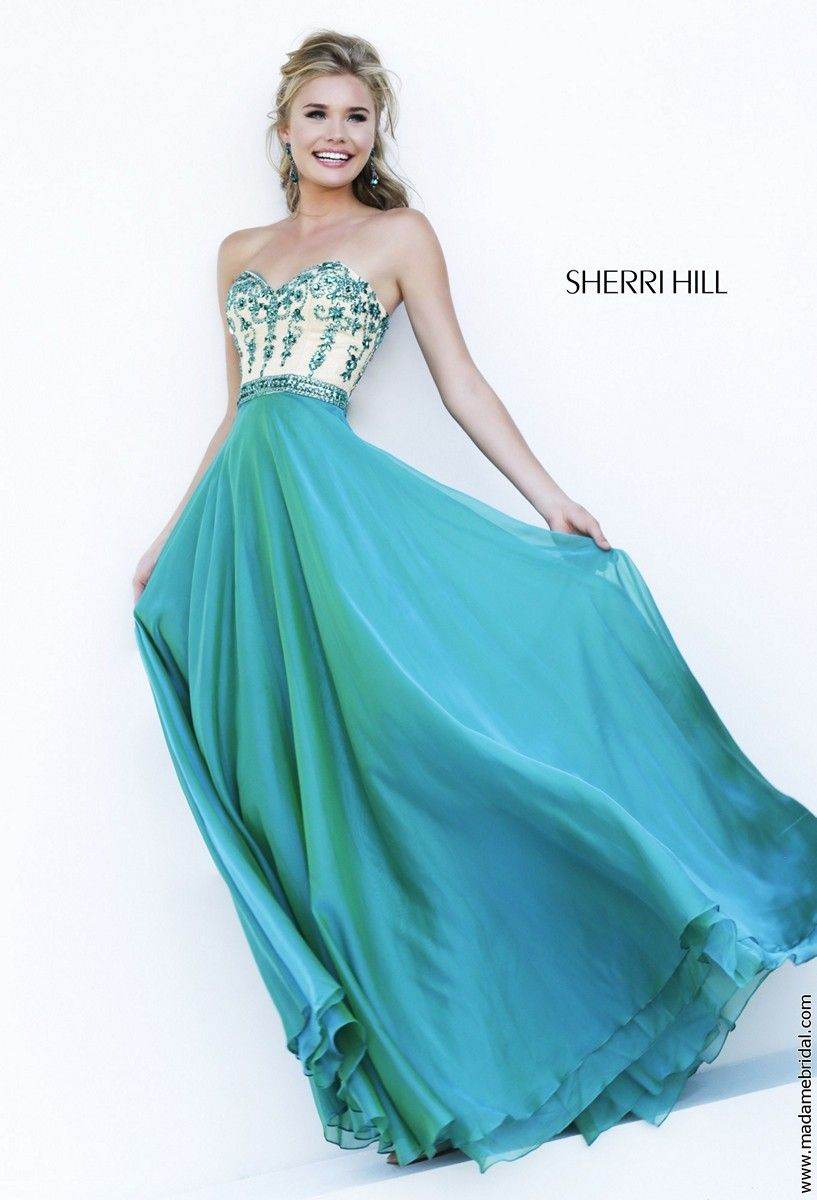 Vines of floral beadwork glide down the nude bodice of Sherri Hill ...