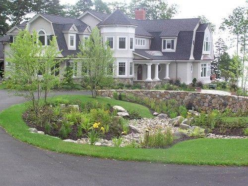 Driveway elevation change circular drive rock landscape for Circular driveway landscaping pictures