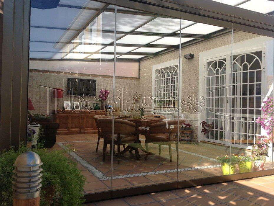 Cerramiento de terraza con techo m vil en madrid patios for Techos moviles para terrazas precios