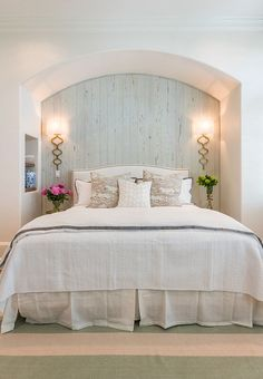 Gorgeous guest bedroom with pale blue cypress wall and gold sconces. Wall sconces are from Horchow.