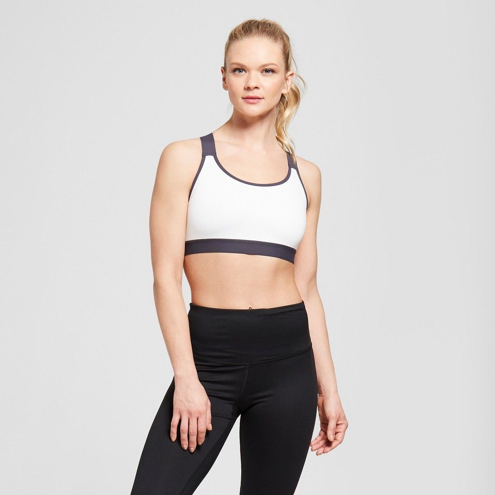 03056ae0f5 The Women s Criss-Cross Strappy Back Sports Bra from C9 Champion features a  strappy back with thick straps that stand out in bold colors.