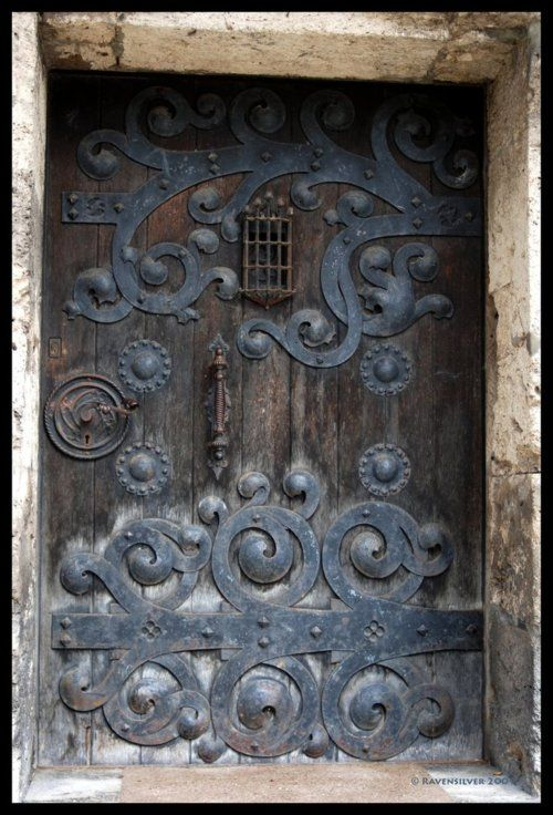 Old Castle Door Love Through Wrought Iron Scroll Work