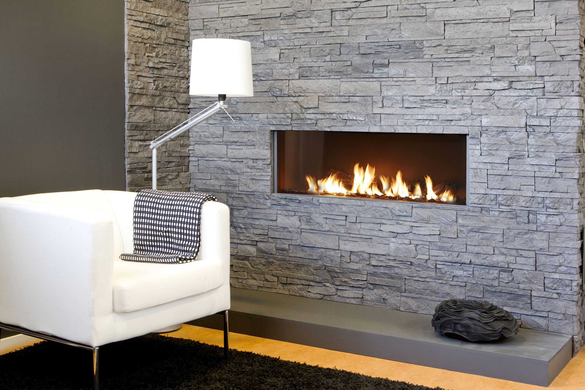 Stacked Wall With White Sofa And Stylish Standing Floor Lamp Living Room Corner Contemporary Modern Electric Fireplace Contemporary Gas Fireplace Gas Fireplace