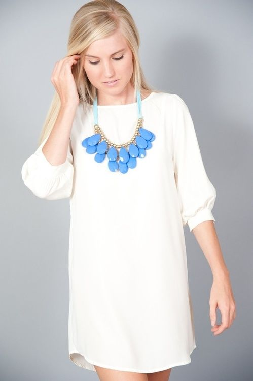 Simple dress. beautiful statement necklace