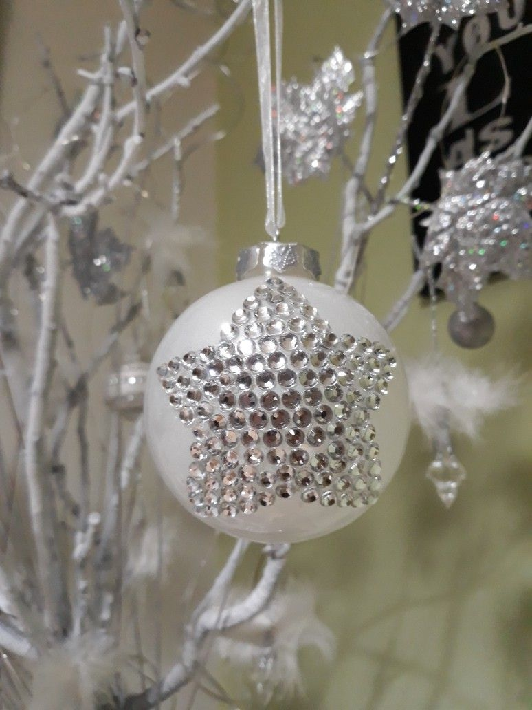 DIY Christmas tree ornament. Plastic clear ball painted with nail polish and decorated with crystal stickers.