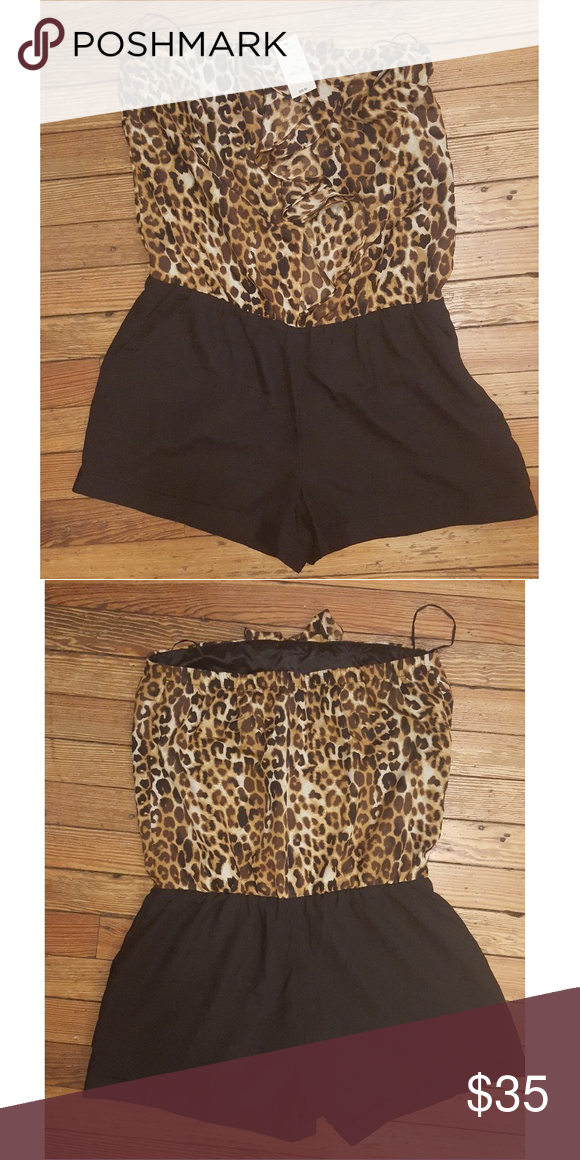 183547a9d597 Express strapless romper Strapless leopard and black romper with ruffle  down the front. Express Shorts