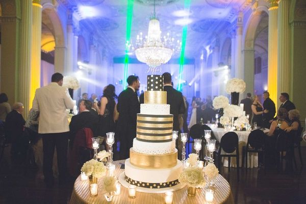 Black, Gold & White Striped Cake |   Photography: Rob and Wynter Photography.   Read More:  http://www.insideweddings.com/weddings/mlb-players-white-black-gold-nye-ballroom-wedding-in-atlanta/806/