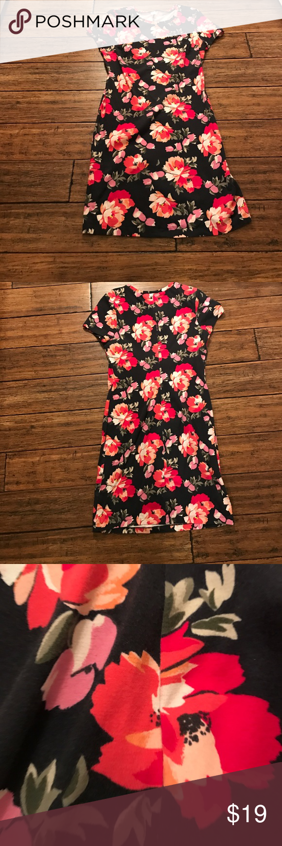 """Old Navy Floral Print Short Sleeve Dress Pretty floral print shirt sleeve dress from Old Navy. Only worn a couple of times. Floral print is on a navy background. 93% cotton, 7% spandex. This has a lot of stretch to it. Approx. 36"""" long. 17"""" armpit to armpit, 15"""" across waist, and 15"""" across hips. Old Navy Dresses"""
