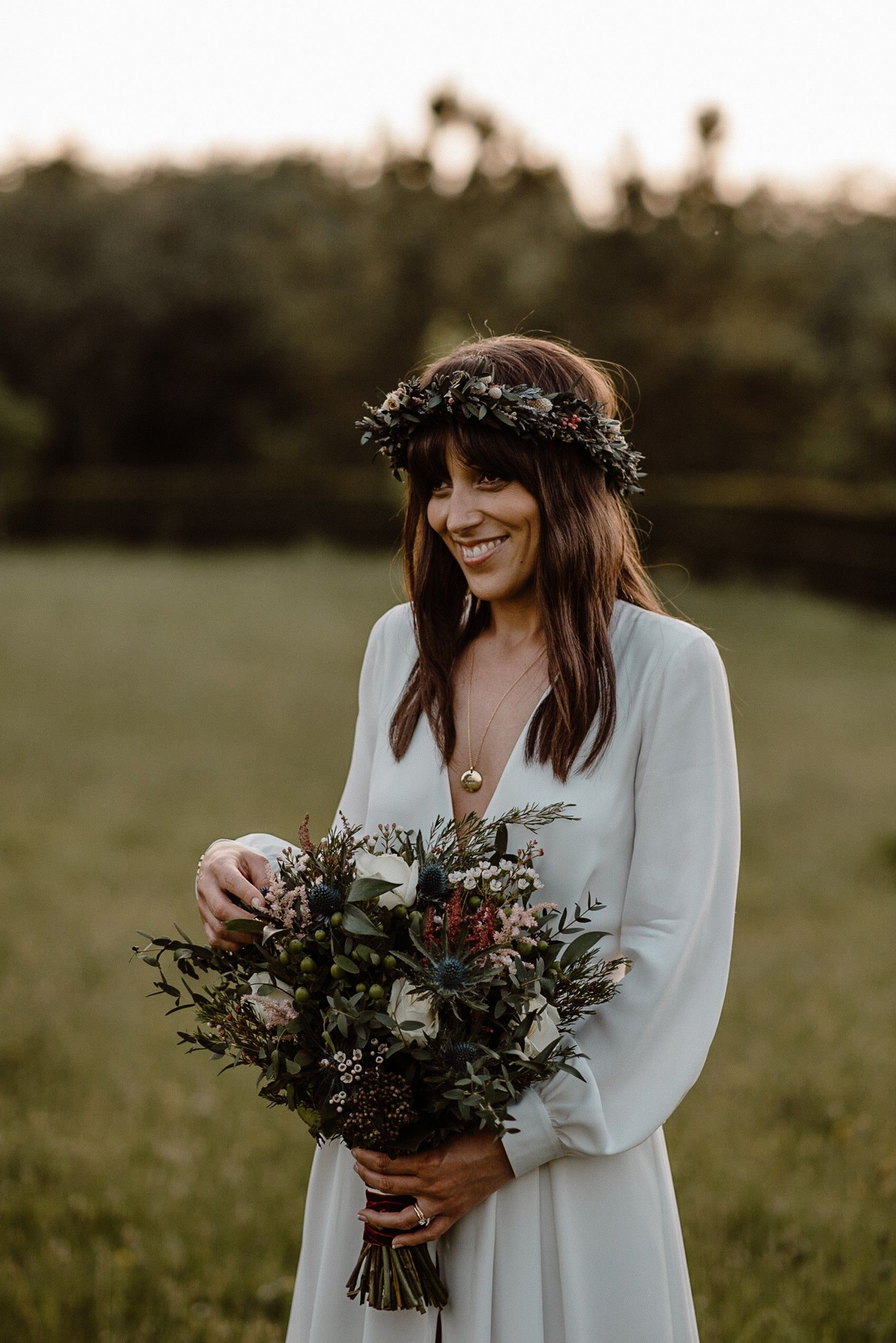 Bride wears a dried flower crown of meadow flowers. Kelly McAllister Photography #flowercrown #driedflowercrown #weddingaccessories #bridalaccessories #weddinghair