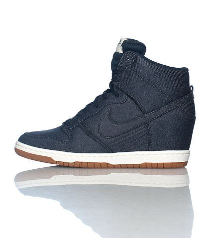 timeless design 08fe4 52206 NIKE High top women s wedge sneaker Lace up closure Denim body Padded  tongue with NIKE logo Cushioned inner sole