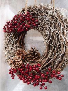 Photo of Ghirlanda natalizia in legno intrecciato da appendere.