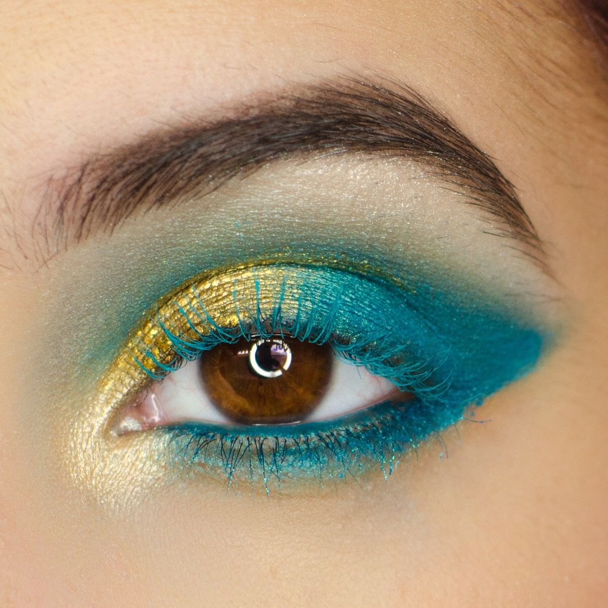 A bold colorful eyeshadow look using teal and gold. I used the new ...
