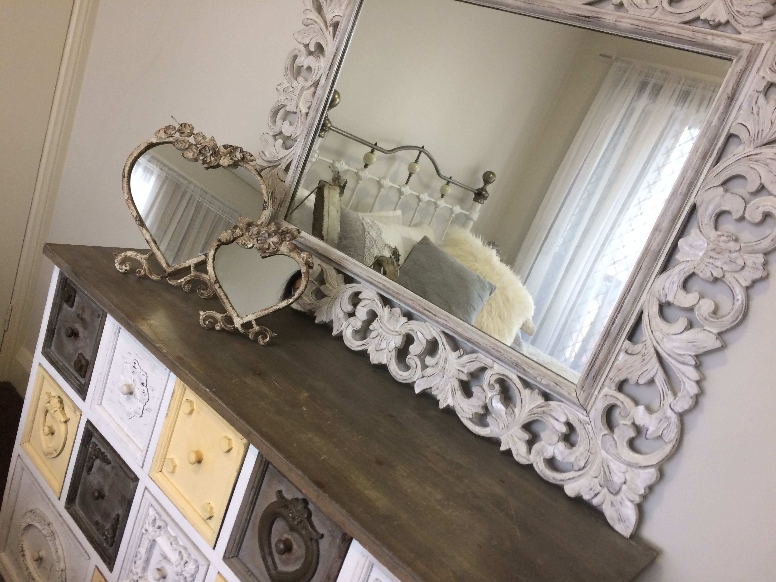 Vintage mirror with two accent mirrors and a grey and white vintage
