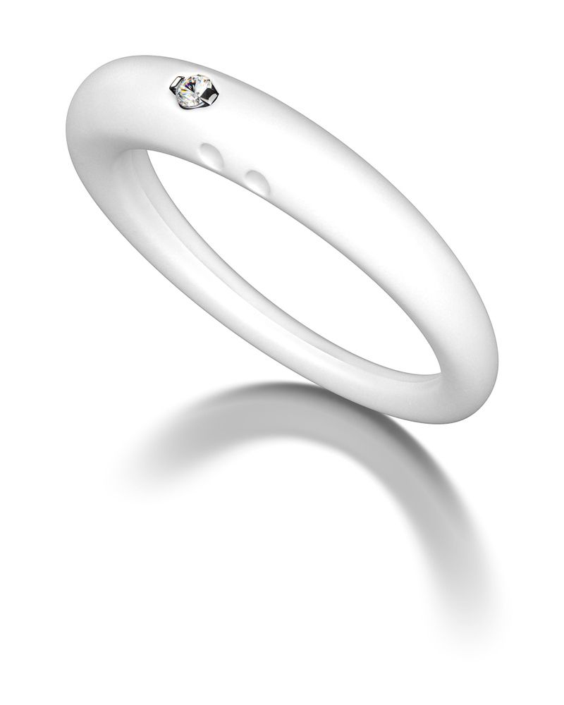 DUEPUNTI White Ring. I remember my dad bought me one like this a long time ago