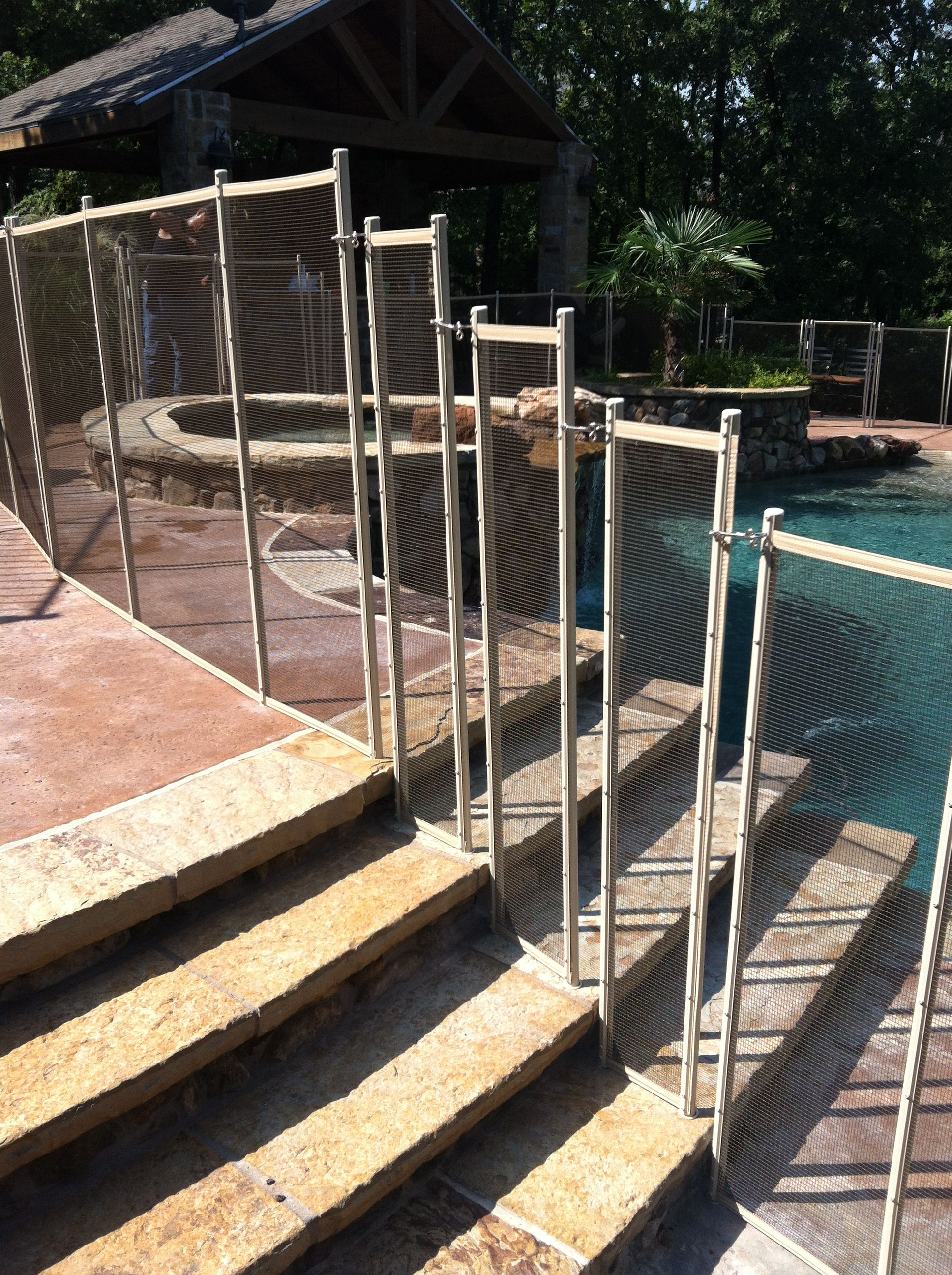 Brown Mesh Pool Fence With Beige Border And Poles Installed On Stairs Backyard Fences Rustic Fence Easy Fence