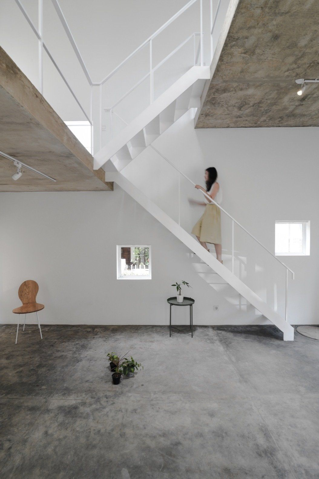 Staircase metal railing and metal tread open tread stairs link the three floors photo 5 of 12 in this skinny minimalist home gets a modern revamp for