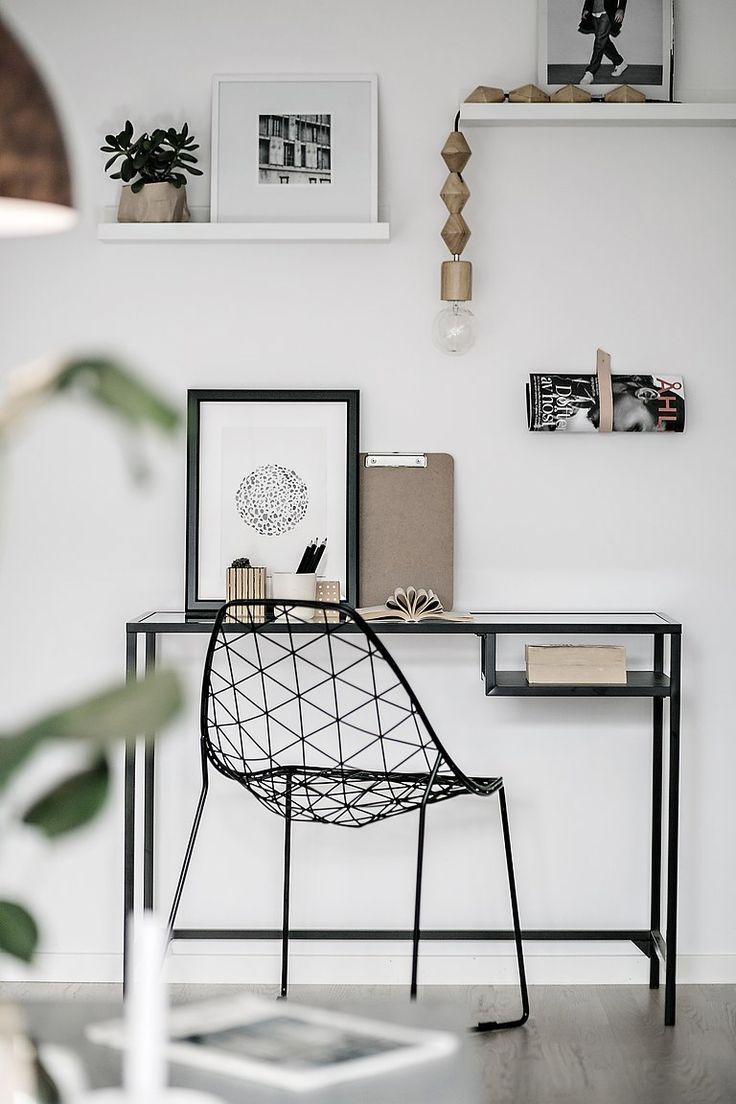 Minimal home office space with wire chair
