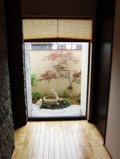 View Onto A Small Japanese Garden.