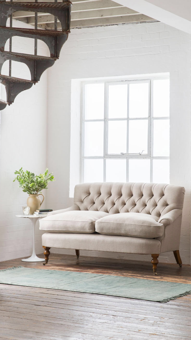 Update your living room furniture with the Emily, a charmingly shaped small sofa (two seater sofa) pictured here in Donegal Linen, Oatmeal (light colour).