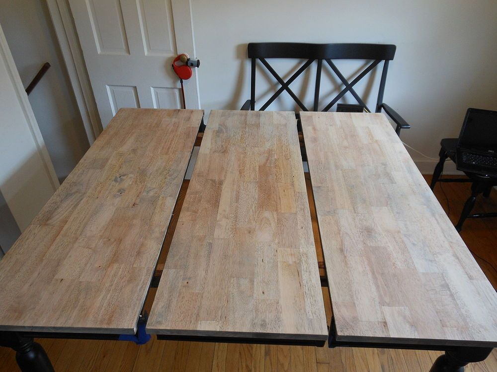 before and after painted dining table top to refinished