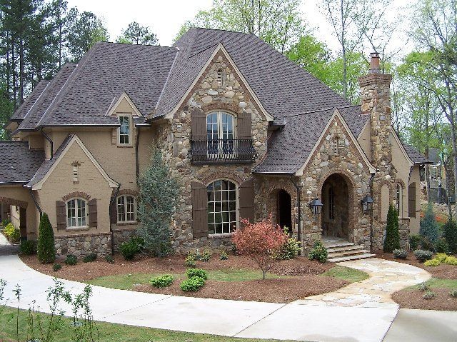 French country style house natural stone rot iron for French country exterior