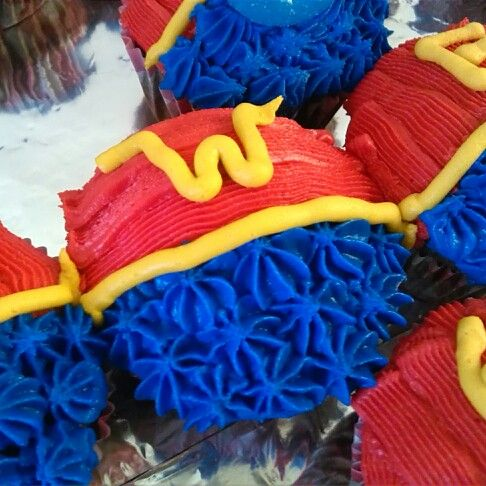 Wonder Woman | cupcakes for my daughters birthday. Homemade vanilla buttercream frosting tinted with gels. Piped the red, then blue, then yellow.